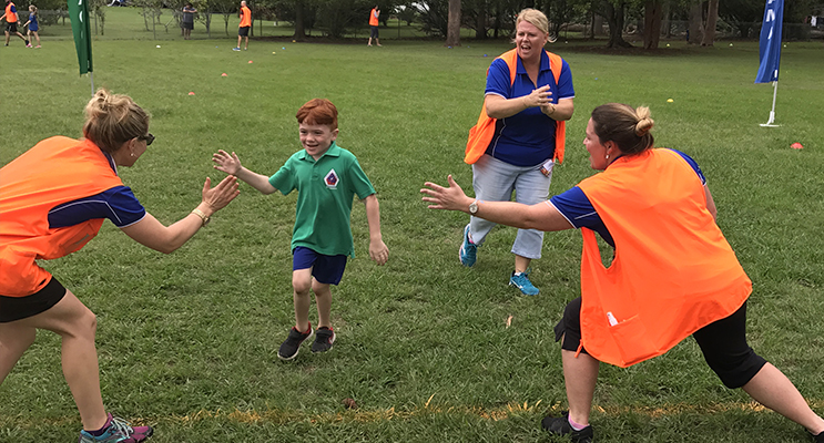 Oaklan Reed is cheered over the line at Wirreanda's cross country last week.