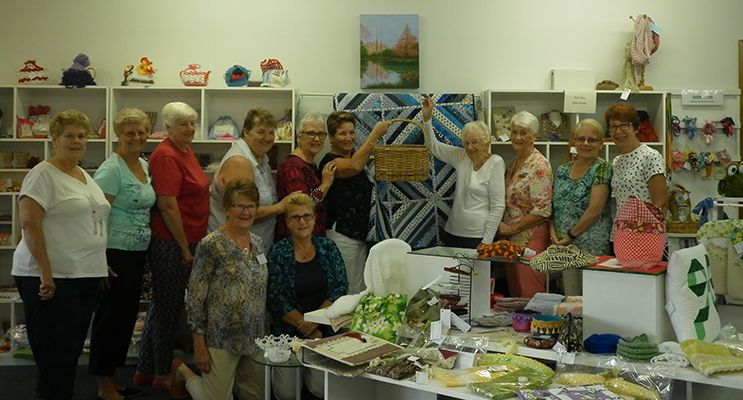 QUILTING & SEWING GROUP: June Wilcox draws the quilt raffle.
