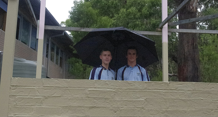 Jacob Stoddard and Ammon Hall in front of the barbecue. Photo by Marian Sampson