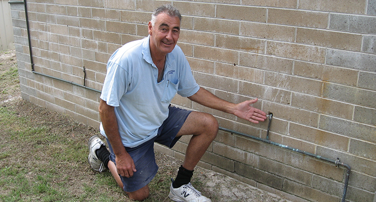Local plumber Geoff Davey with an example of the old lead soldered fittings.