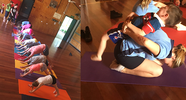 Students in this very special Yoga class, working together and learning new skills. Photos by Mikaela Corrigan