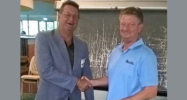 :   Allan Gleeson being congratulated by Richard Simmer, Hawks Nest Golf Club Secretary Manager, for winning the coveted Putt for Dough Jacket.