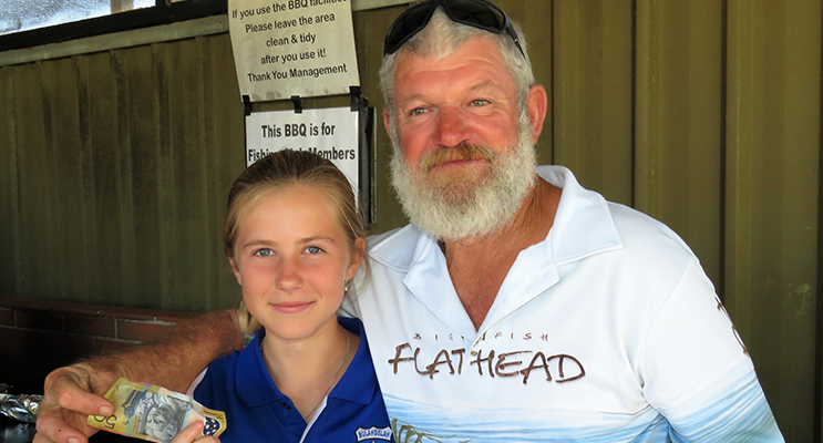 : Junior Champion Olivia Smith from Bulahdelah Fishing Club accepts her prize from Grant Bidgood.