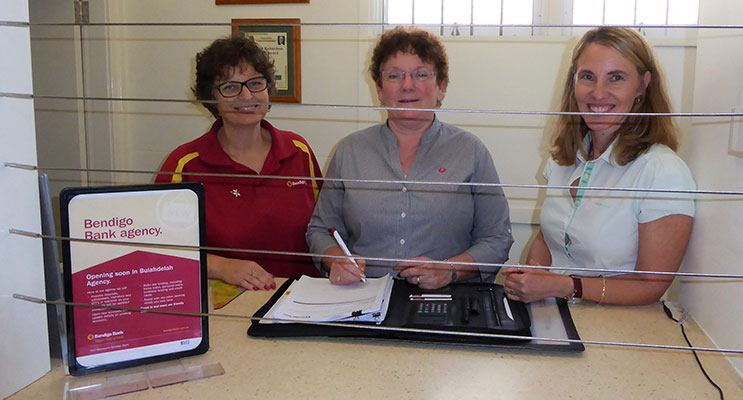 Bendigo Bank Area Manager Kim Rowley, Agent Judy Dixon and Port Macquarie Branch Manager Kerry Lumby sign contracts for the Bulahdelah Agency. Photo: Supplied.