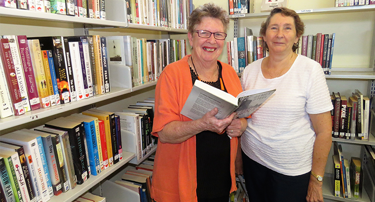 Past librarians Diane Burns and Loraine Farrell on the final day of operation at the CWA rooms.