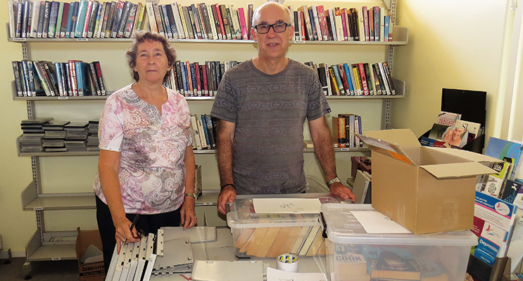 Loraine Farrell and MidCoast Library Services Manager Chris Jones dismantle the library.