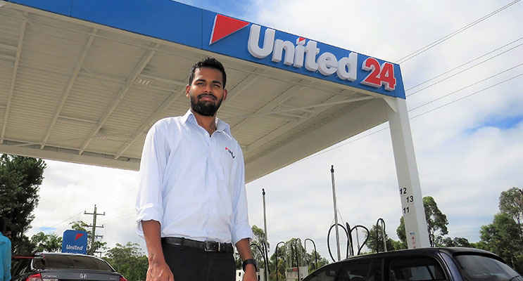 : Employee Martin Routthu at the new United service station in Bulahdelah.