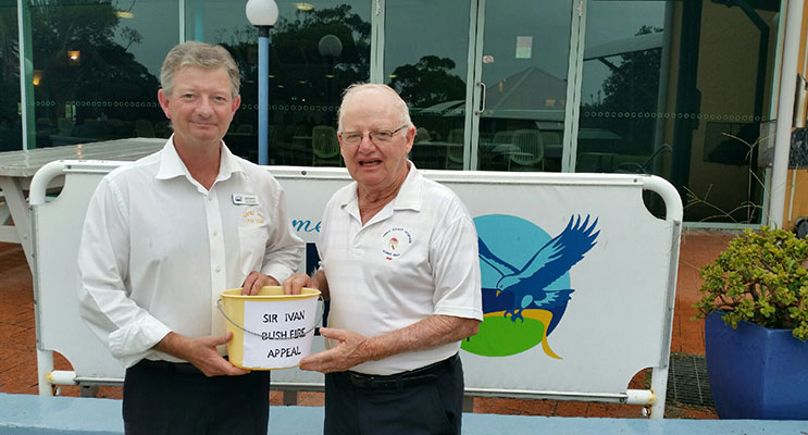 BUSHFIRE APPEAL: Hawks Nest Golf Club General Manager Richard Simmer and Pip Sullivan.