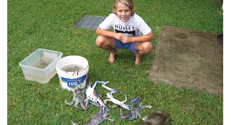 Colin Cohen with his haul of crabs.