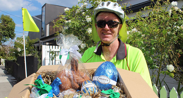 Postie Daniel Flemming prepares to deliver chocolates this Easter.