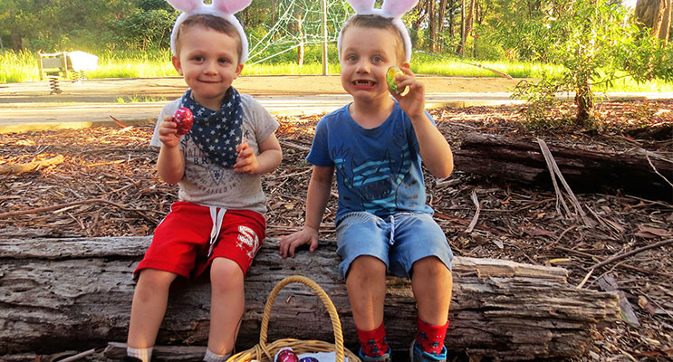 Easter Egg Hunt: Nathan and Ethan Swann collect eggs left by the Easter Bunny.