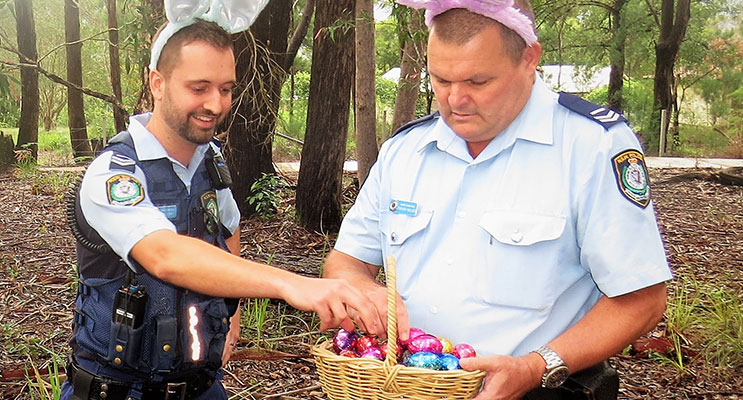 Senior Constables Feeney and Mcleod examine the chocolate eggs allegedly left by the Easter Bunny.