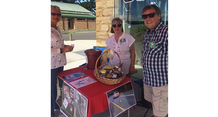 Jill and Peter Madden selling raffle tickets to Adrienne Ingram in Tea Gardens.