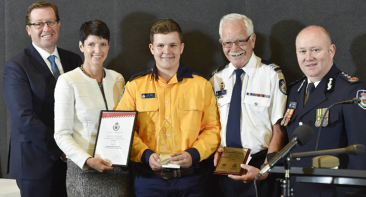 Minister for Emergency Services Troy Grant, Port Stephens MP Kate Washington, Young Volunteer of the Year Alexander Slade, Williamtown-Salt Ash Brigade captain David Thomas, and NSW RFS commissioner Shane Fitzsimmons.