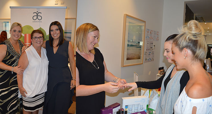 Organisers Katrina Becker and Katie Lavender with MC Cath Breadner in the centre.(left) Jamberry Nail Consultant Melody Hughes showing attendees how to apply her products.(right)