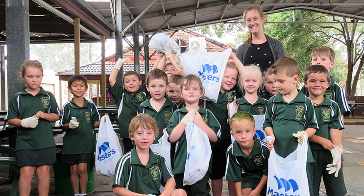 Clean Up Australia Day: Karuah PS K/1 students with teacher Miss Laura Blatch.