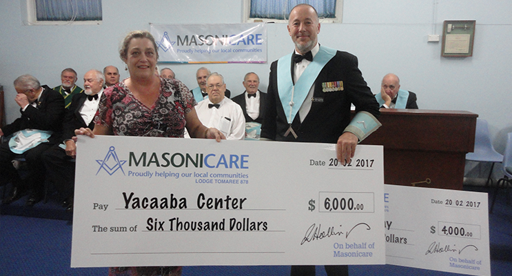 The Yacaaba Centre being presented with their cheque from Tomaree Lodge.