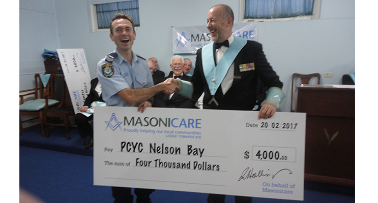 Port Stephens PCYC being presented with their cheque from Tomaree Lodge.