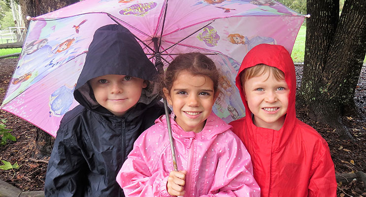 Raincoats and Brollies: Zac Moran, Abbiegail Ray and Andrew Kent prepared for the wet weather.