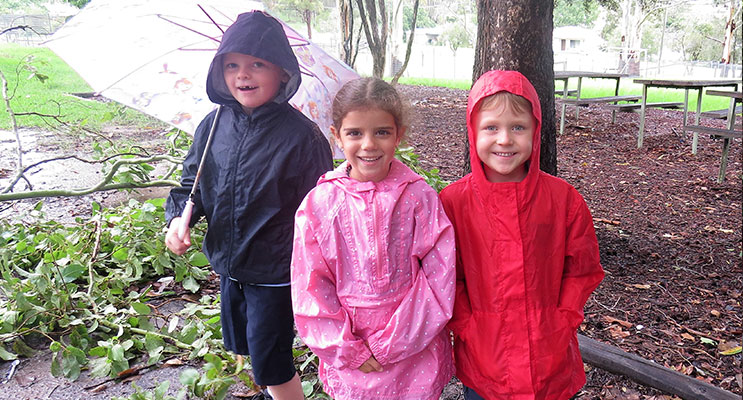 : Wet Weather Fun: Zac Moran, Abbiegail Ray and Andrew Kent enjoy the muddy conditions.