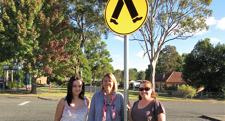 School Crossing Safety: Student Georgia Roberts, Deputy Deb Gilbert and parent Melissa Smith urge drivers to slow down in school zones.