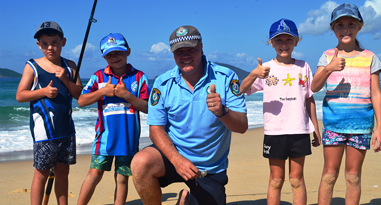 FISHING DAY:  Karuah Police Constable Trent Moffat gets the thumbs up.