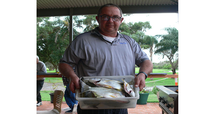 Trevor Peirson displaying some great bream he caught.