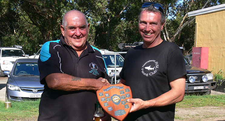 Hawks Nest Golf Club Fishing President Jim McDonald congratulating and handing over the perpetual shield to Narrabeen RSL Fishing President Steve Law.