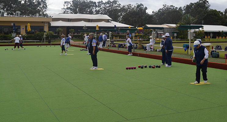 Tea Gardens Women's Bowling Club bowlers on the green.