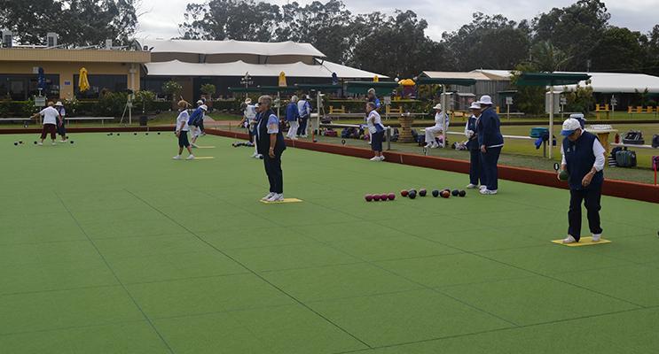 Tea Gardens Women's Bowling Club bowlers on the green.
