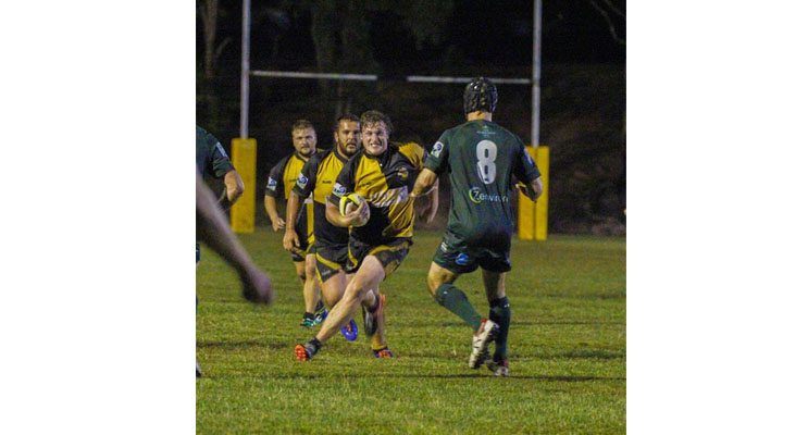 Adam Beehag making a run for a gap in the Merewether defence.  Photo by: Danielle Underwood