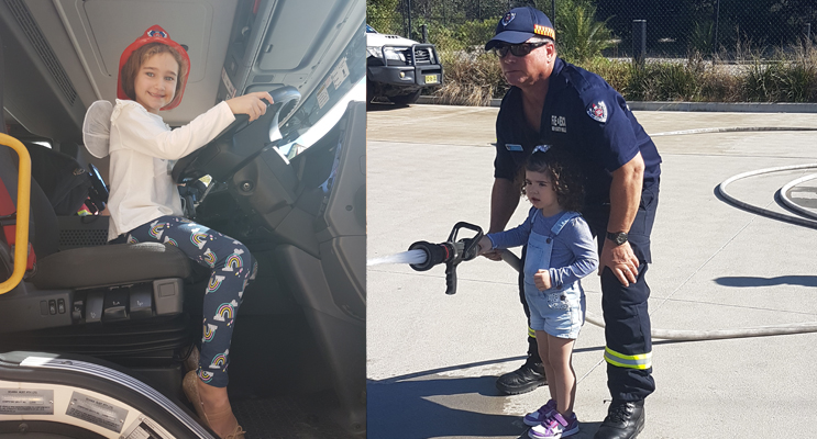 Sienna, age six, at the wheel. Photos by Sarah Stokes (left) Ava, age two, with firefighter Shaun. Photos by Sarah Stokes (right)