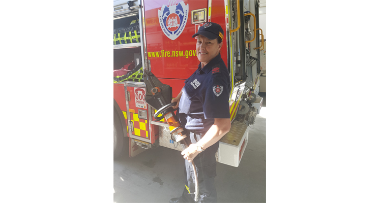 Margaret Petersen, Firefighter with a Combination Tool. Photos by Sarah Stokes