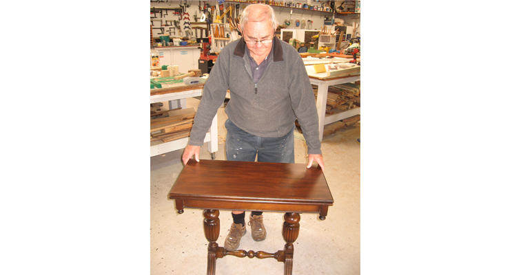 Col with his restored antique table.