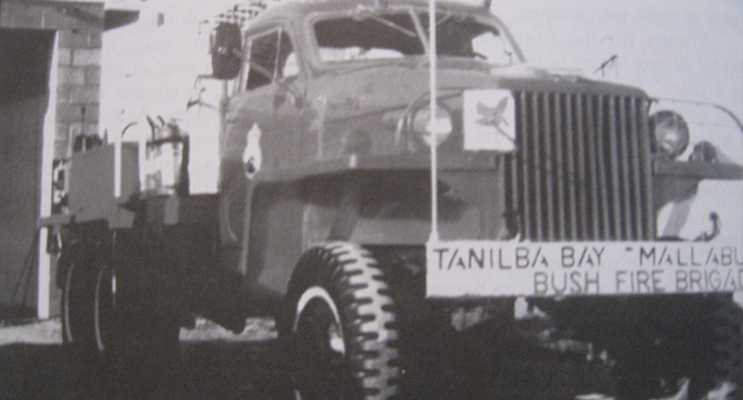 An early photo of a Tanilba tanker beside the original station