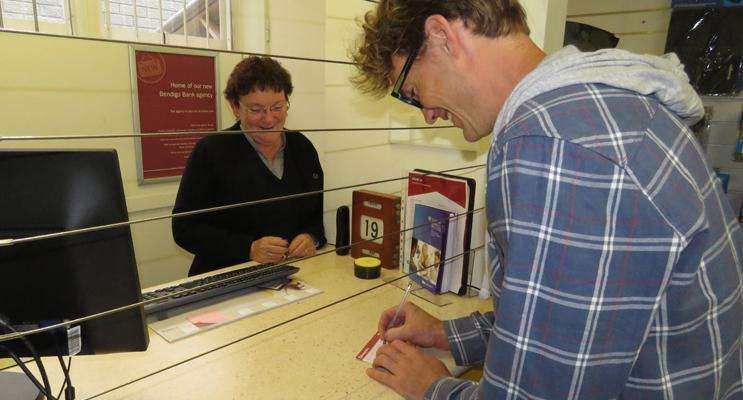 Bendigo Bank Agent Judy Dixon with customer Kris Mayan at the Bulahdelah Agency.