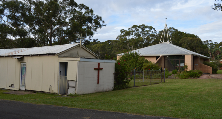 The old and the new: St Francis' Anglican Church current 1984 church behind the original garage building on the Ferodale site.