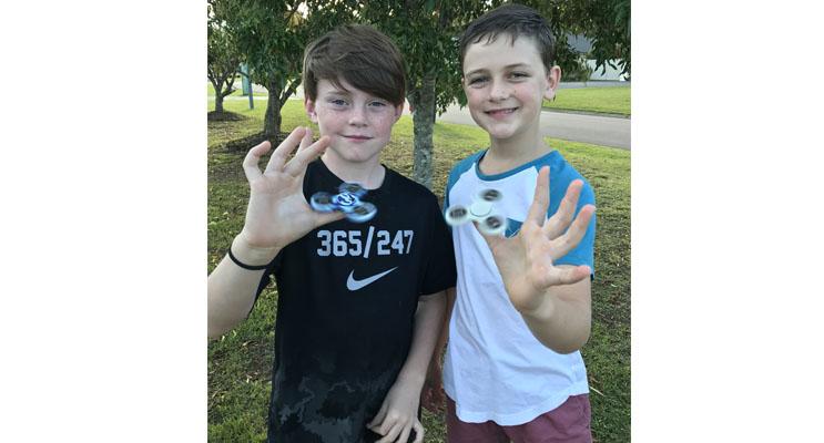Cooper McKenna and Hayden Reddon love their fidget spinners.