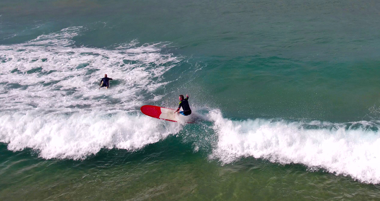 The boys battle it out on the waves. Photo courtesy of Hover UAV Aerial Photography