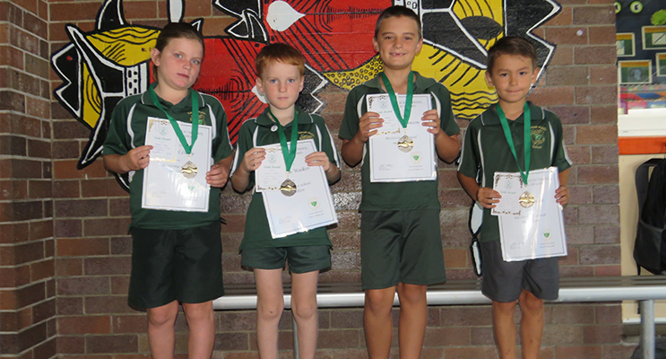 Rachel, Harmon, Lachlan and Toby with their Karuah PS Medallions.