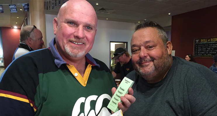 Chris Doohan and Rod Kerr get set for the raffles to raise some funds for the Taylor family.