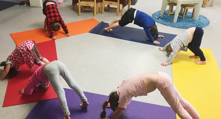 Mini Yoga stars strike a pose.