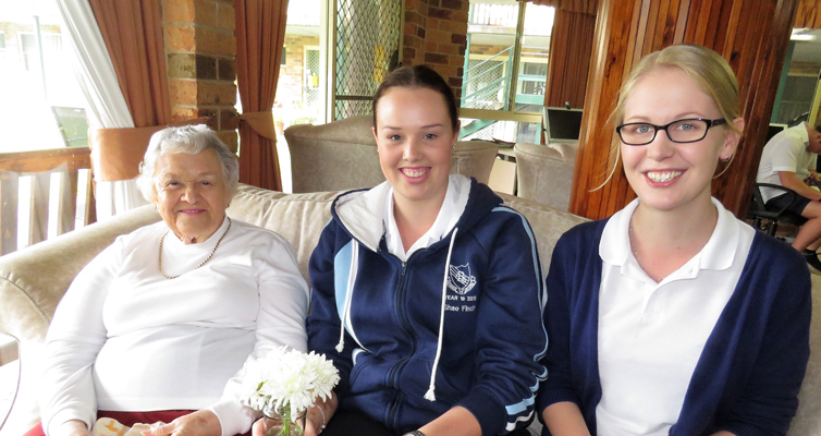 Mother's Day Visit: Students Shae Finch and Kaitlyn Gregory with resident Fay Skerry-Collins.