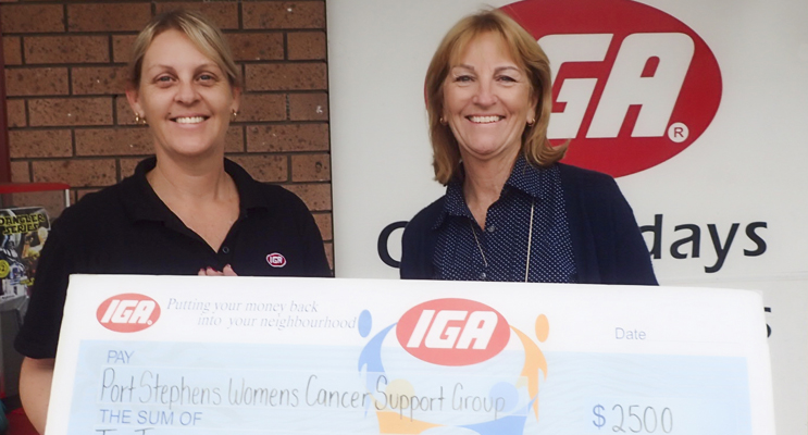 Michelle Dand, Manager IGA Nelson Bay presenting Rhondda Shaw, Secretary, PSWSG Inc with the cheque for $2500.  Photo supplied