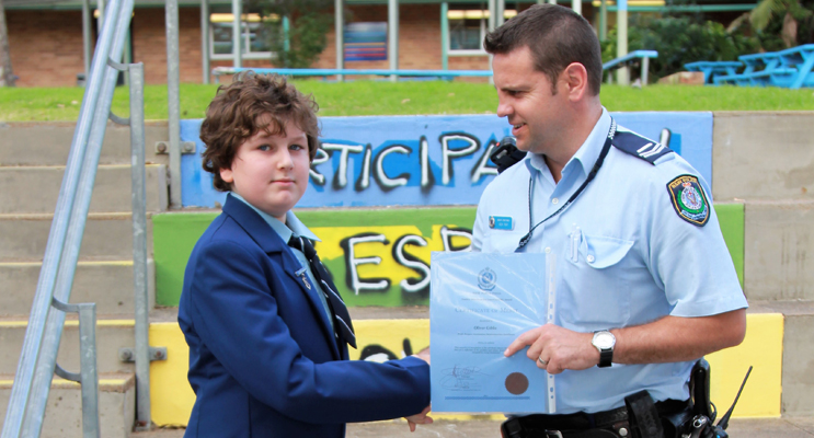 Senior Constable Ashley Ray presents the PBL Award to Oliver Gibbs. Photo: BCS