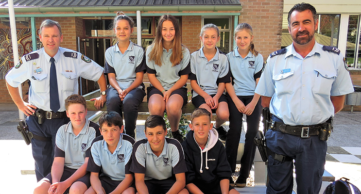 Mid North Coast School Liaison Officer Senior Constable Stephen Jefferies and Manning Great Lakes School Liaison Officer Senior Constable David Russell with BCS Year 7 students.