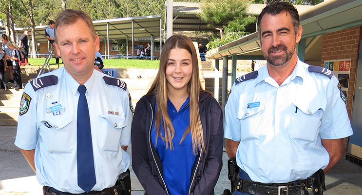 Senior Constables Stephen Jefferies and David Russell talk with Year 10 student Courtneay Harding about a career in the police force.