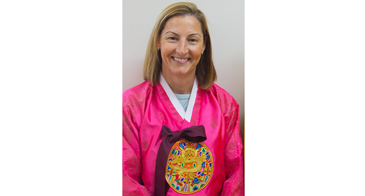 Principal Miss Young in traditional South Korean dress.