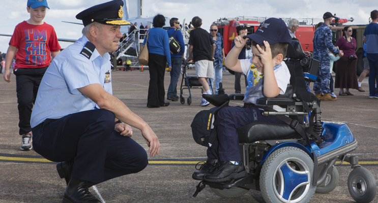 Senior Australian Defence Force Officer at Williamtown, Air Commodore Craig Heap, and five-year-old Josh Ryan who receives support from Muscular Dystrophy NSW.