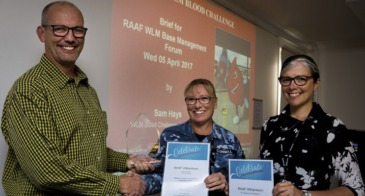 Williamtown Blood Challenge Coordinator Sam Hayes, presenting awards to Amanda Cornell and Mary-Ann Mellor.